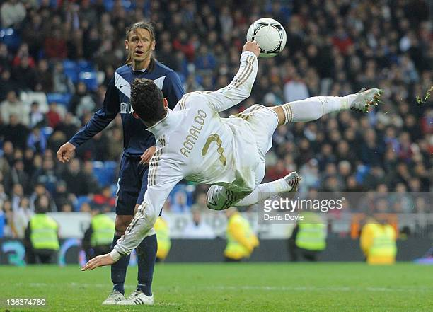 Cristiano Ronaldo of Real Madrid shoots at goal during the round 16 Copa del Rey 1st leg match between Real Madrid and Malaga at Bernabeu on January...