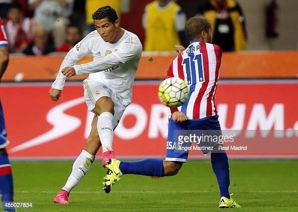 Cristiano Ronaldo of Real Madrid shoots on goal past Alberto Lora of Sporting Gijon during the La Liga match between Sporting Gijon and Real Madrid...