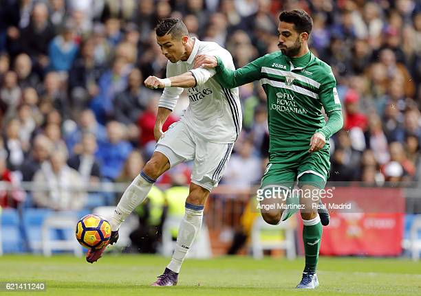 Cristiano Ronaldo of Real Madrid shoots on goal under pressure from Pablo Insua of Leganes during the La Liga match between Real Madrid CF and...