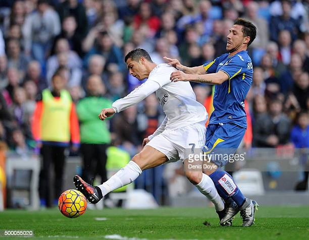 Cristiano Ronaldo of Real Madrid shoots past Roberto Lago of Getafe to score his team's 4th goal during the La Liga match between Real Madrid CF and...