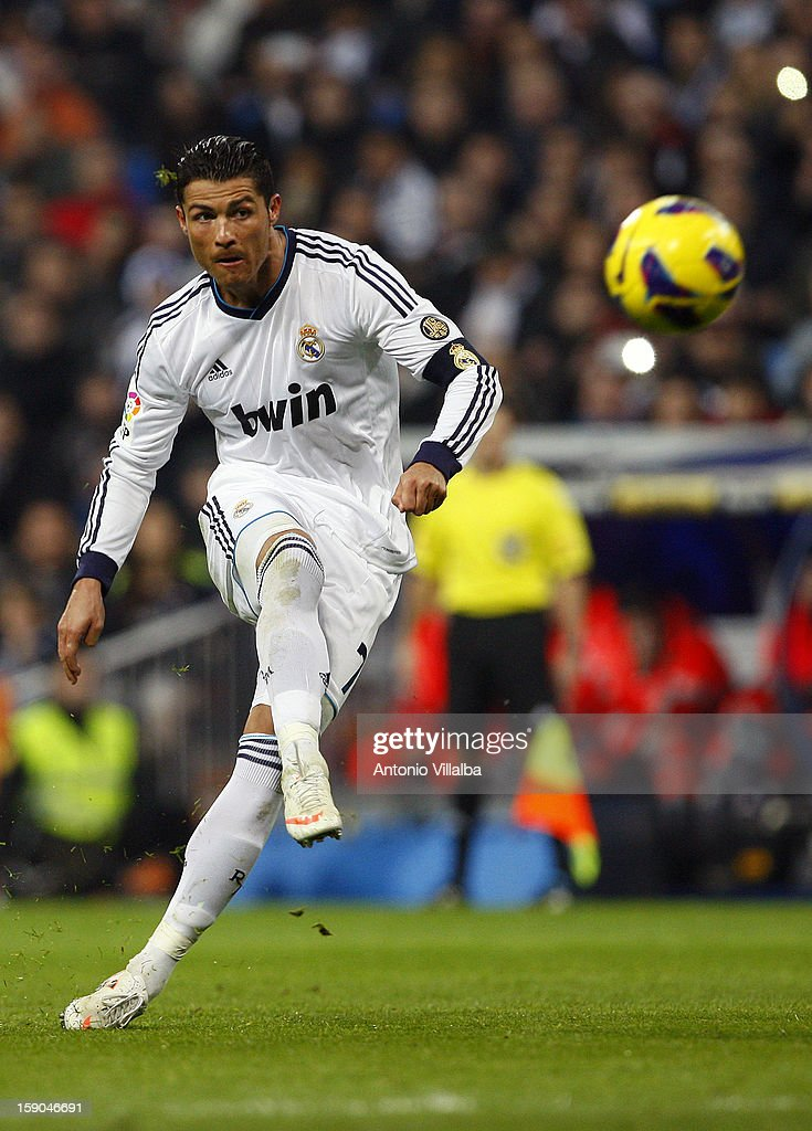 <a gi-track='captionPersonalityLinkClicked' href=/galleries/search?phrase=Cristiano+Ronaldo+-+Soccer+Player&family=editorial&specificpeople=162689 ng-click='$event.stopPropagation()'>Cristiano Ronaldo</a> of Real Madrid shoots the ball during the La Liga match between Real Madrid and Real Sociedad at Estadio Santiago Bernabeu on January 6, 2013 in Madrid, Spain.