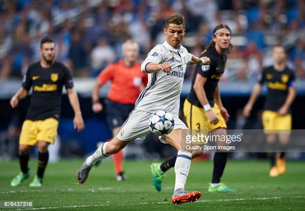 Cristiano Ronaldo of Real Madrid shoots to goal during the UEFA Champions League Semi Final first leg match between Real Madrid CF and Club Atletico...