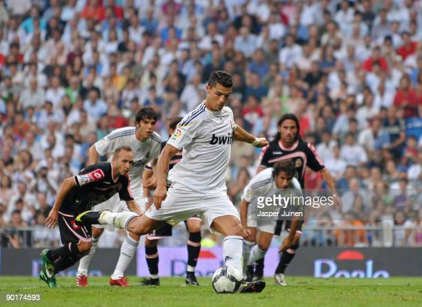 Cristiano Ronaldo of Real Madrid shoots to score from the penalty spot during the La Liga match between Real Madrid and Deportivo La Coruna at the...