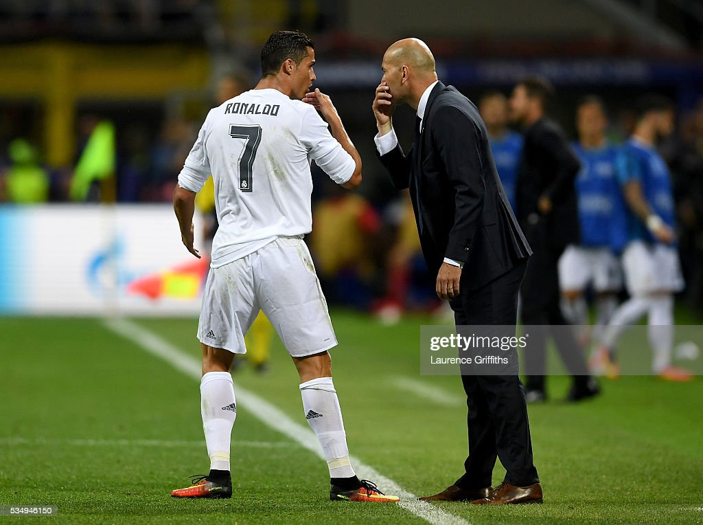<a gi-track='captionPersonalityLinkClicked' href=/galleries/search?phrase=Cristiano+Ronaldo+-+Soccer+Player&family=editorial&specificpeople=162689 ng-click='$event.stopPropagation()'>Cristiano Ronaldo</a> of Real Madrid speaks to head coach <a gi-track='captionPersonalityLinkClicked' href=/galleries/search?phrase=Zinedine+Zidane&family=editorial&specificpeople=172012 ng-click='$event.stopPropagation()'>Zinedine Zidane</a> during the UEFA Champions League Final match between Real Madrid and Club Atletico de Madrid at Stadio Giuseppe Meazza on May 28, 2016 in Milan, Italy.