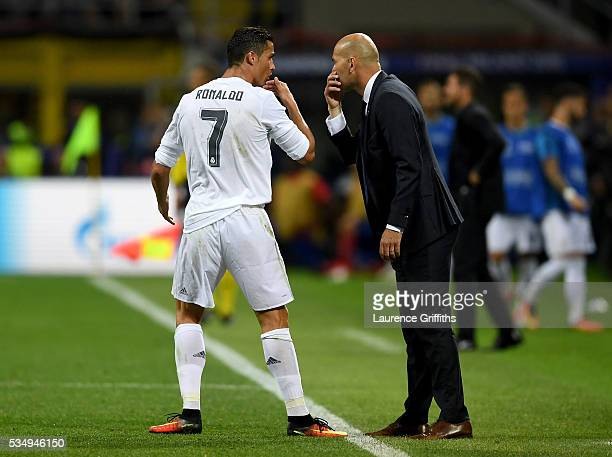 Cristiano Ronaldo of Real Madrid speaks to head coach Zinedine Zidane during the UEFA Champions League Final match between Real Madrid and Club...