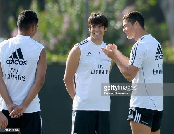 Cristiano Ronaldo of Real Madrid speaks with teammates Kaka and Carlos Henrique Casimiro during a training session at UCLA on August 2 2013 in Los...