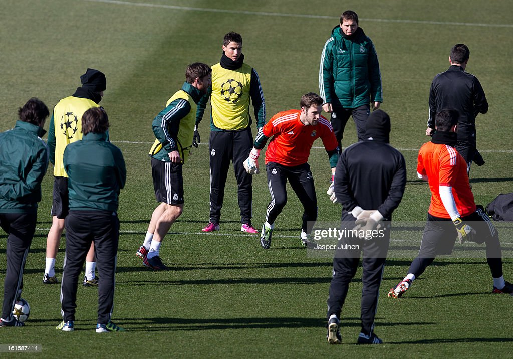 Cristiano Ronaldo (C) of Real Madrid stands amid his teammates during a training session ahead of the UEFA Champions League match between Real Madrid CF and Manchester United at the Valdebebas training ground on February 12, 2013 in Madrid, Spain.