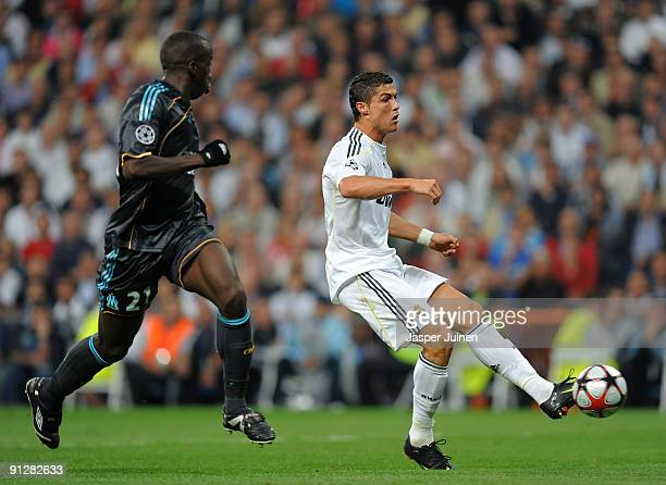 Cristiano Ronaldo of Real Madrid strikes to score the opening goal past Souleymane Diawara of Marseille during the Champions League group C match...