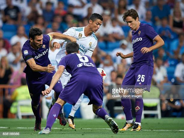 Cristiano Ronaldo of Real Madrid surrounded by players of Fiorentina during the Trofeo Santiago Bernabeu match between Real Madrid and ACF Fiorentina...