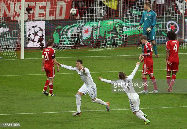 Cristiano Ronaldo of Real Madrid takes a free kick and scores the team's fourth goal during the UEFA Champions League semi final second leg match...
