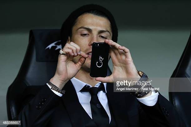 Cristiano Ronaldo of Real Madrid takes a picture with his mobile phone prior of the UEFA Champions League Quarter Final second leg match between...
