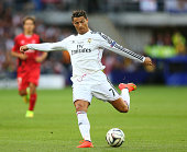 Cristiano Ronaldo of Real Madrid takes a shot during the UEFA Super Cup between Real Madrid and Sevilla FC at Cardiff City Stadium on August 12 2014...