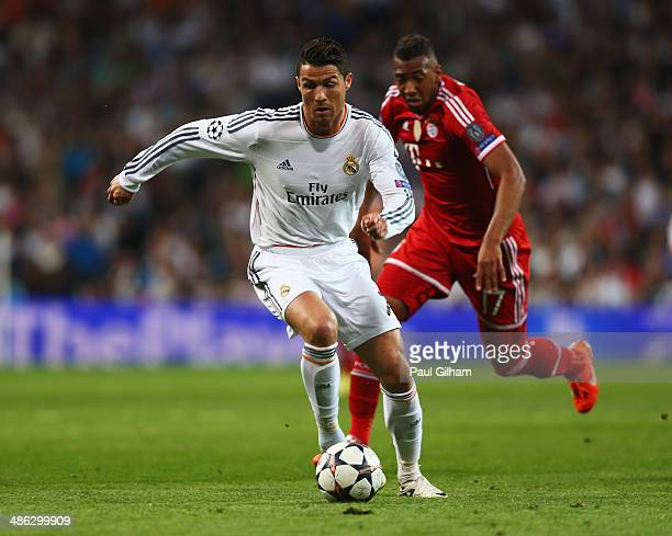 Cristiano Ronaldo of Real Madrid takes on Jerome Boateng of Bayern Muenchen during the UEFA Champions League semifinal first leg match between Real...