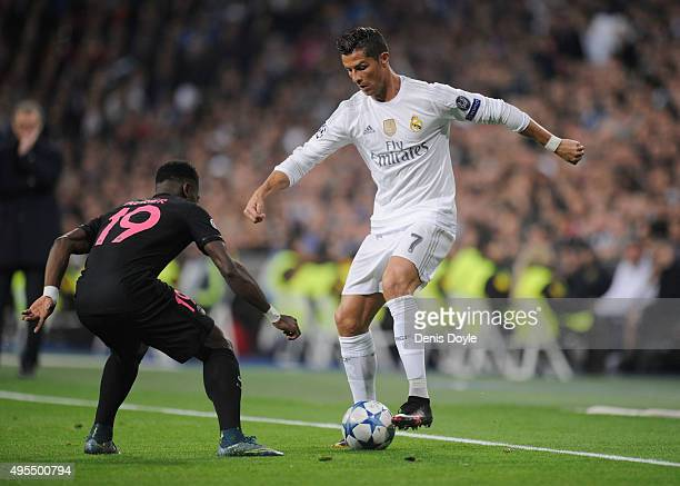 Cristiano Ronaldo of Real Madrid takes on Serge Aurier of PSG during the UEFA Champions League Group A match between Real Madrid CF and Paris...