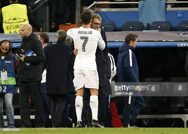 Cristiano Ronaldo of Real Madrid talks to coach of PSG Laurent Blanc after the UEFA Champions League match between Real Madrid and Paris SaintGermain...