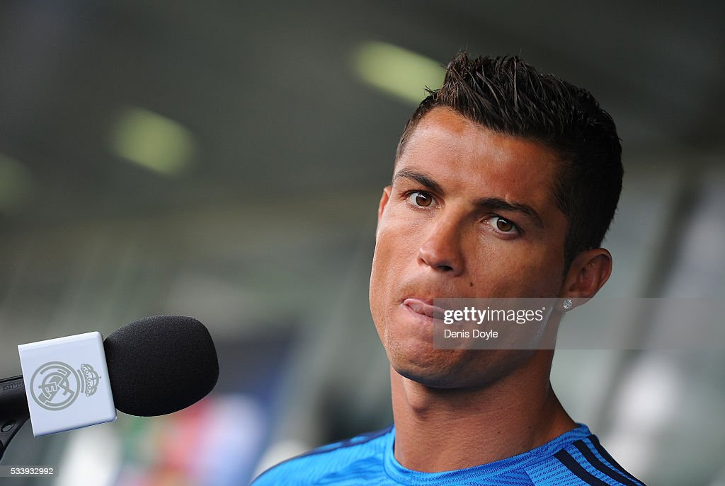 <a gi-track='captionPersonalityLinkClicked' href=/galleries/search?phrase=Cristiano+Ronaldo+-+Soccer+Player&family=editorial&specificpeople=162689 ng-click='$event.stopPropagation()'>Cristiano Ronaldo</a> of Real Madrid talks to members of the press at the mixed zone after the team training session at the Real Madrid Open Media Day ahead of the UEFA Champions League Final against Club Atletico Madrid at Valdebebas training ground on May 24, 2016 in Madrid, Spain.