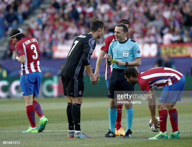 Cristiano Ronaldo of Real Madrid talks with referee of the match Cuneyt Cakir during the UEFA Champions League semi final second leg match between...