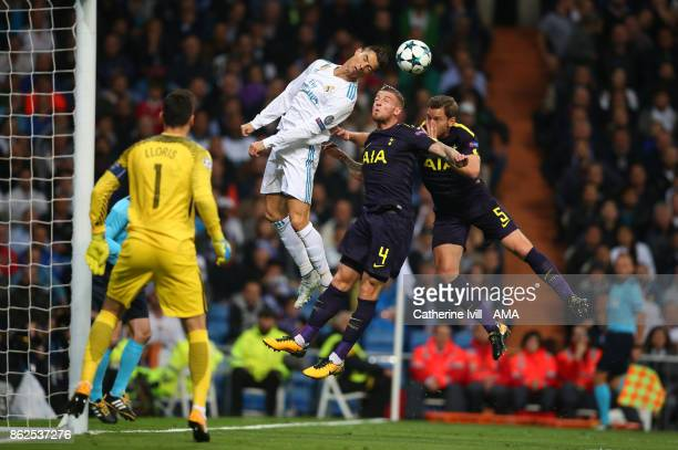 Cristiano Ronaldo of Real Madrid Toby Alderweireld and Jan Vertonghen of Tottenham Hotspur battle for possession in the air during the UEFA Champions...