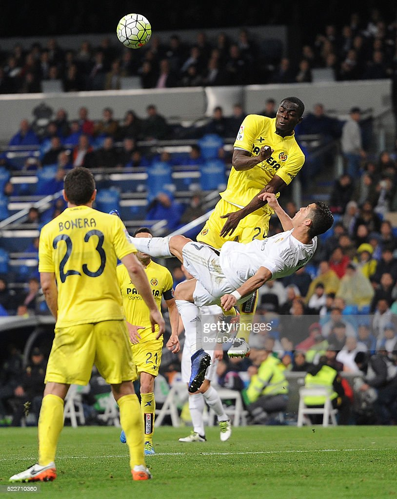 Cristiano Ronaldo of Real Madrid tries an overhead kick beside Eric Bailly of Villarreal CF during the La Liga match between Real Madrid and Villarreal at Estadio Santiago Bernabeu on April 20, 2016 in Madrid, Spain.