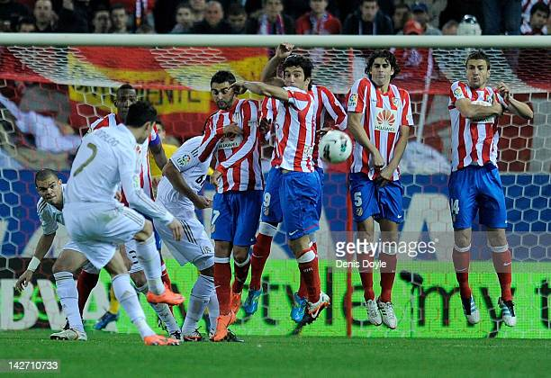 Cristiano Ronaldo of Real Madrid tries to shoot a frre kick over the Atletico Madrid wall during the La Liga match between Club Atletico de Madrid...