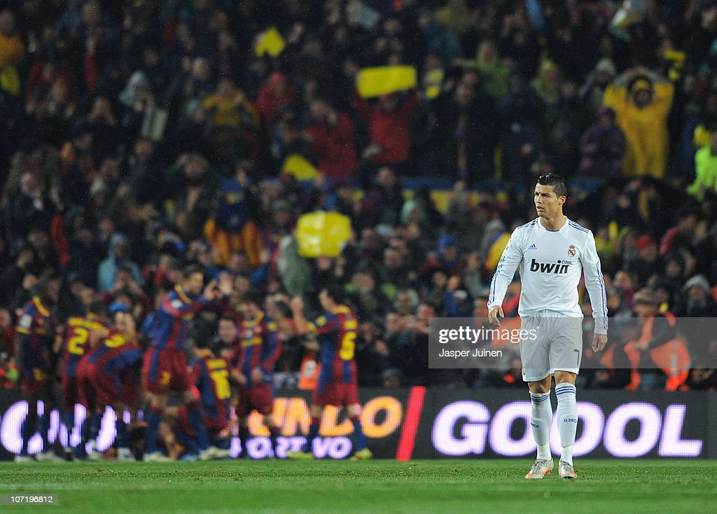 Cristiano Ronaldo of Real Madrid trudges back to the half wayline after Barcelona scored their second goal during the la liga match between Barcelona and Real Madrid at the Camp Nou stadium on November 29, 2010 in Barcelona, Spain.