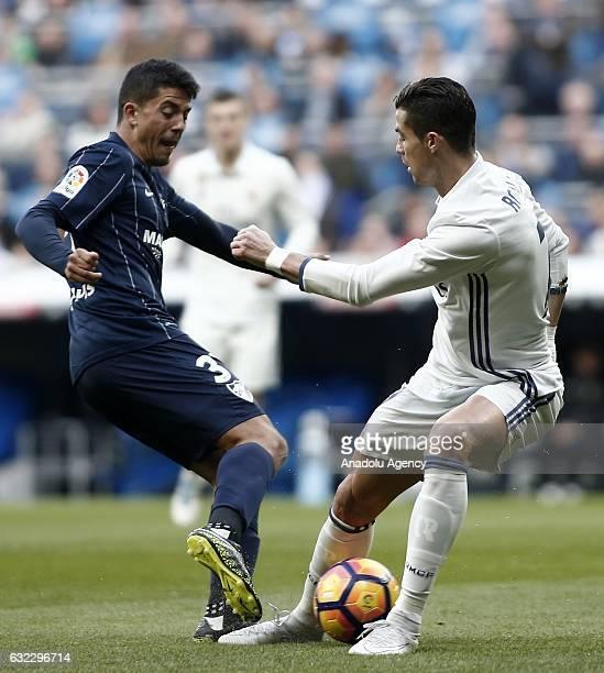 Cristiano Ronaldo of Real Madrid vies with Pablo Fornals of Malaga during the La Liga match between Real Madrid CF and Malaga CF at the Bernabeu on...