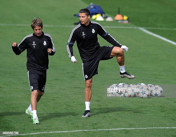 Cristiano Ronaldo of Real Madrid warms up with Fabio Coentrao during the Real Madrid CF training at Valdebebas grounds ahead of the UEFA Champions...