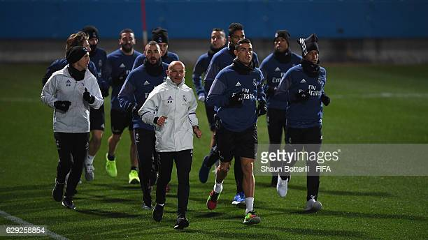 Cristiano Ronaldo of Real Madrid warms up with teammates during a training session at Mitsuzawa Football Stadium on December 12 2016 in Yokohama Japan