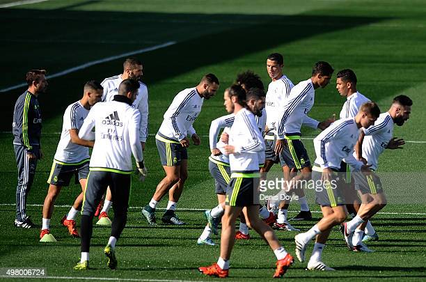 Cristiano Ronaldo of Real Madrid warmsup with teammates during the team training session ahead of the La Liga match between Real Madrid and Barcelona...