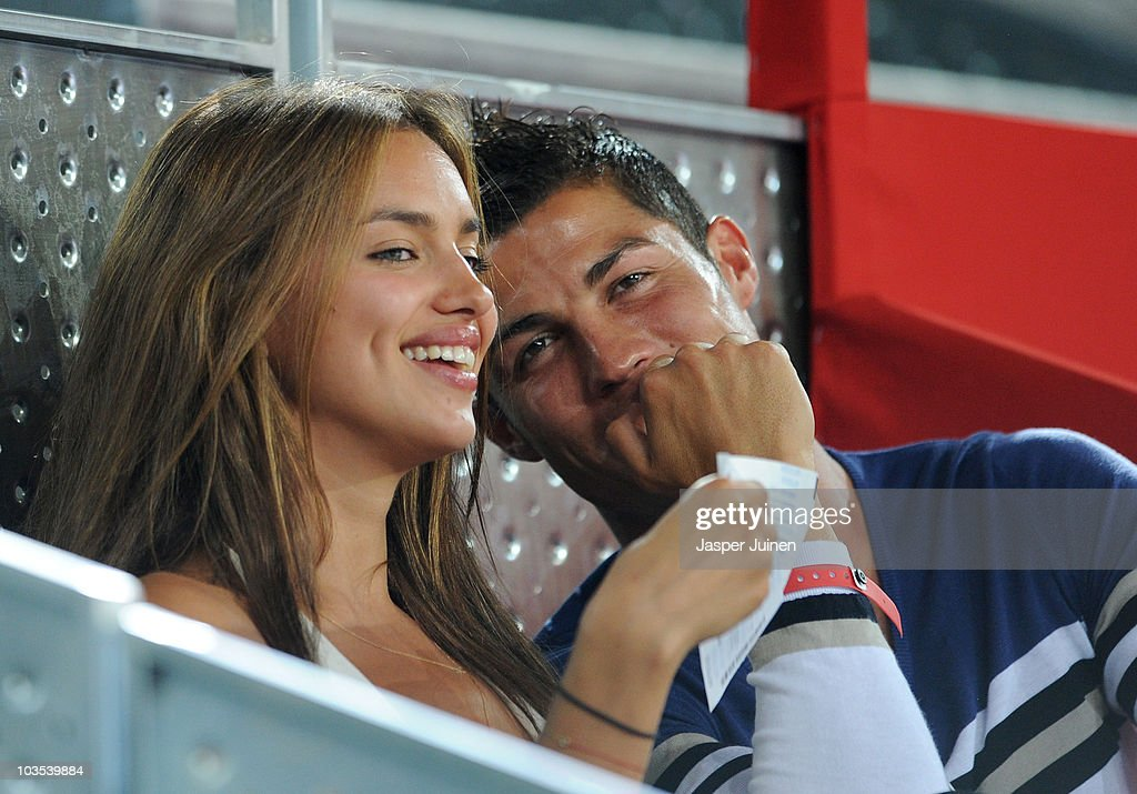 Cristiano Ronaldo (R) of Real Madrid watches a friendly basketball between Spain and the USA with Irina Shayk at La Caja Magica on August 22, 2010 in Madrid, Spain.