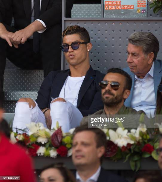 Cristiano Ronaldo of REal Madrid watches the semifinals match between Novak Djokovic of Serbia and Rafael Nadal of Spain during day eight of the...