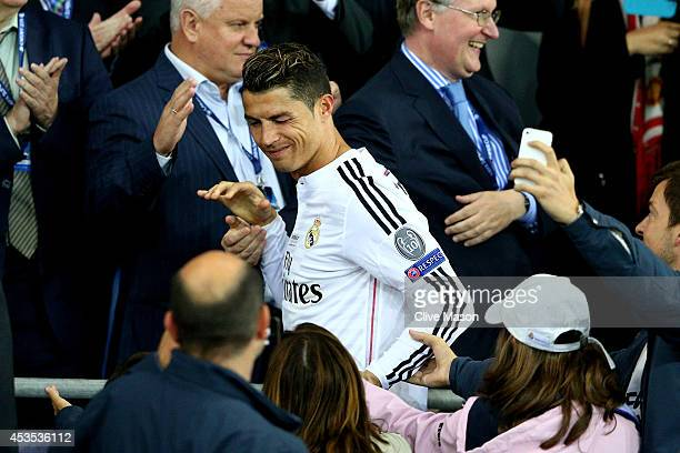 Cristiano Ronaldo of Real Madrid winks at fans as he goes up to receive his winners medal following his team's 20 victory during the UEFA Super Cup...