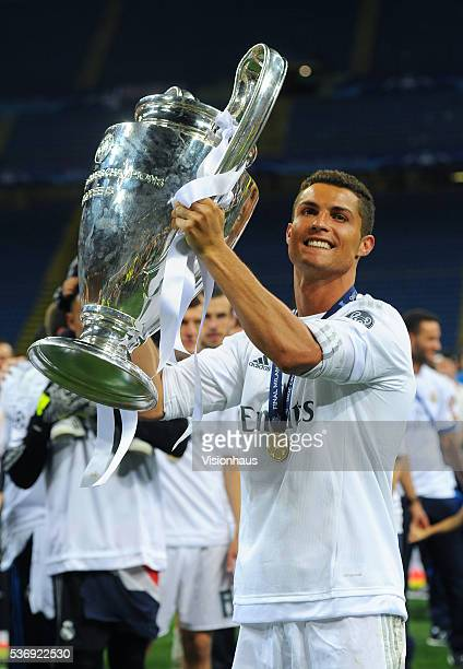 Cristiano Ronaldo of Real Madrid with the Champions League trophy after winning the UEFA Champions League Final between Real Madrid v Club Atletico...