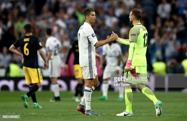 Cristiano Ronaldo of Real shakes hands with goalkeeper Jan Oblak of Atletico during the UEFA Champions League Semi Final first leg match between Real...