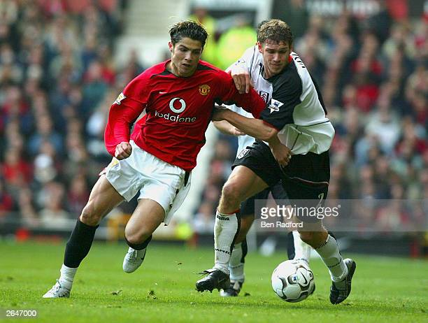 Cristiano Ronaldo of United holds off Mortiz Volz of Fulham during the FA Barclaycard Premiership match between Manchester United and Fulham at Old...