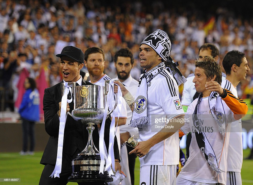 Cristiano Ronaldo, Pepe and Fabio Coentrao hold the Copa del Rey trophy after beating Barcelona 2-1 in the final at Estadio Mestalla on April 16, 2014 in Valencia, Spain.