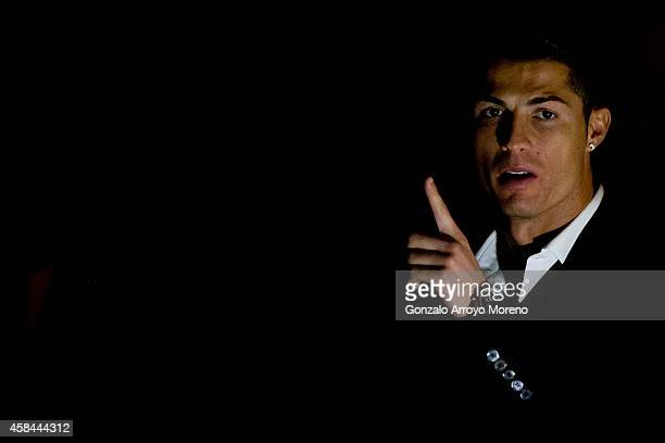 Cristiano Ronaldo points as he leaves a press conference held after receiving the Golden Boot award at Melia Castilla hotel on November 5 2014 in...