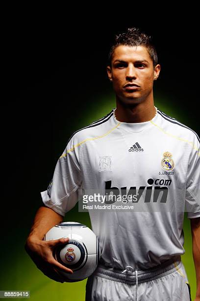Cristiano Ronaldo poses before his official presentation as a new Real Madrid player at the Santiago Bernabeu Stadium on July 6 2009 in Madrid Spain