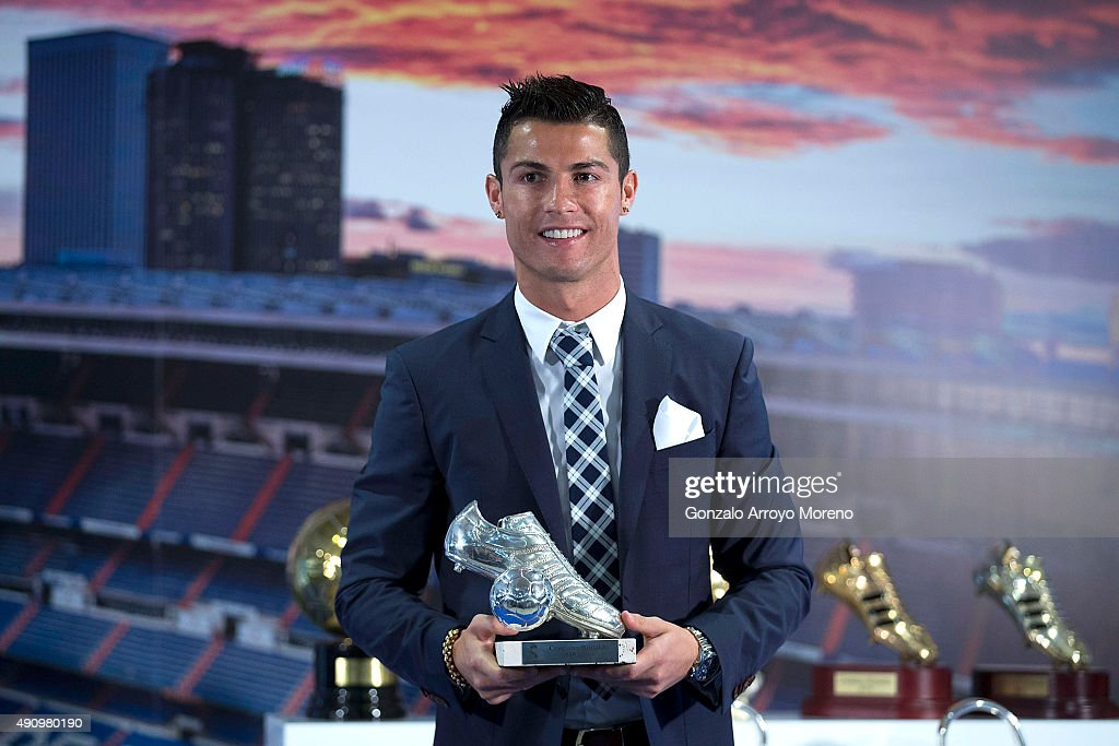 Cristiano Ronaldo poses for a picture with his trophy as all-time top scorer of of Real Madrid CF at Honour box-seat of Santiago Bernabeu Stadium on October 2, 2015 in Madrid, Spain. Portuguese palyer Cristiano Ronaldo overtook on his last UEFA Champions League match against Malmo FF Raul,s record as Real Madrid all-time top scorer.