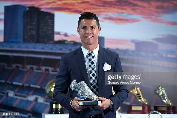 Cristiano Ronaldo poses for a picture with his trophy as alltime top scorer of of Real Madrid CF at Honour boxseat of Santiago Bernabeu Stadium on...