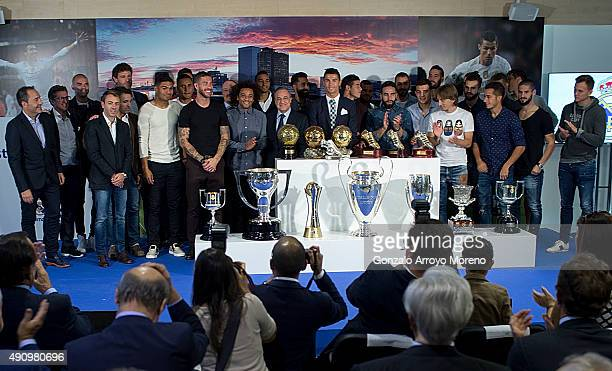 Cristiano Ronaldo poses for a picture with his trophy as alltime top scorer of Real Madrid CF lines up with president Florentino Perez and all his...