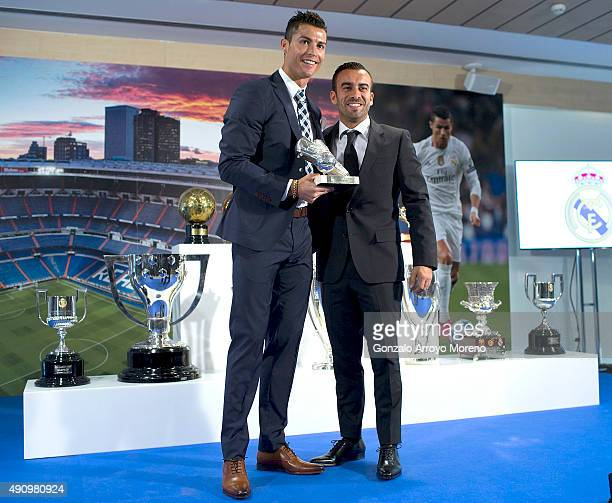 Cristiano Ronaldo poses for a picture with his trophy as alltime top scorer of of Real Madrid CF and his manager Jorge Mendes at Honour boxseat of...