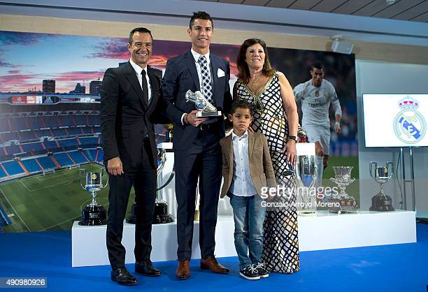 Cristiano Ronaldo poses for a picture with his trophy as alltime top scorer of of Real Madrid CF with his son Cristiano Ronald JR mother Maria...