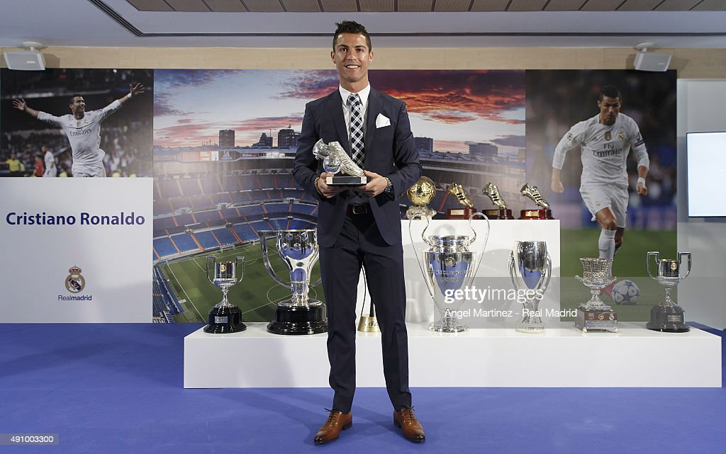 Cristiano Ronaldo poses for a picture with his trophy as all-time top scorer of of Real Madrid CF at Honour box-seat of Santiago Bernabeu Stadium on October 2, 2015 in Madrid, Spain. Portuguese player Cristiano Ronaldo overtook Raul's goal scoring record on his last UEFA Champions League match against Malmo FF to become Real Madrid's all-time top scorer.