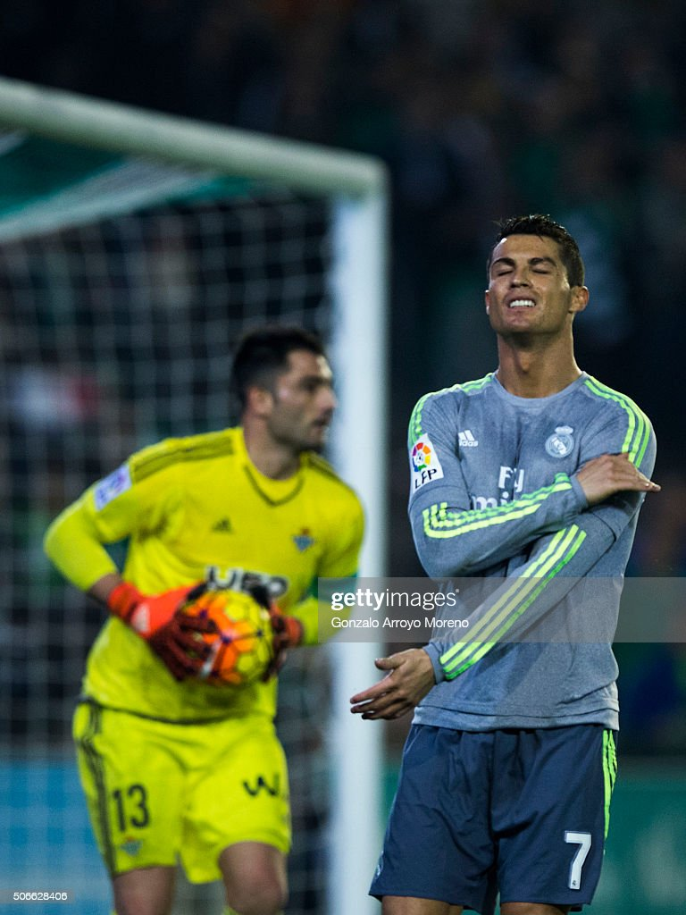 <a gi-track='captionPersonalityLinkClicked' href=/galleries/search?phrase=Cristiano+Ronaldo+-+Soccer+Player&family=editorial&specificpeople=162689 ng-click='$event.stopPropagation()'>Cristiano Ronaldo</a> (R) reacts as he fail to score ahead goalkeeper Antonio Adan of Real Betis Balompie during the La Liga match between Real Betis Balompie and Real Madrid CF at Estadio Benito Villamarin on January 24, 2016 in Seville, Spain.