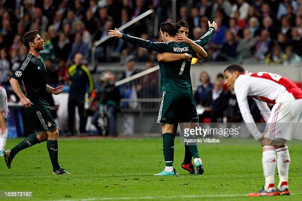Cristiano Ronaldo Sami Khedira and Xabi Alonso of Real Madrid celebrates a goal during the UEFA Champions League Group D match between Ajax Amsterdam...