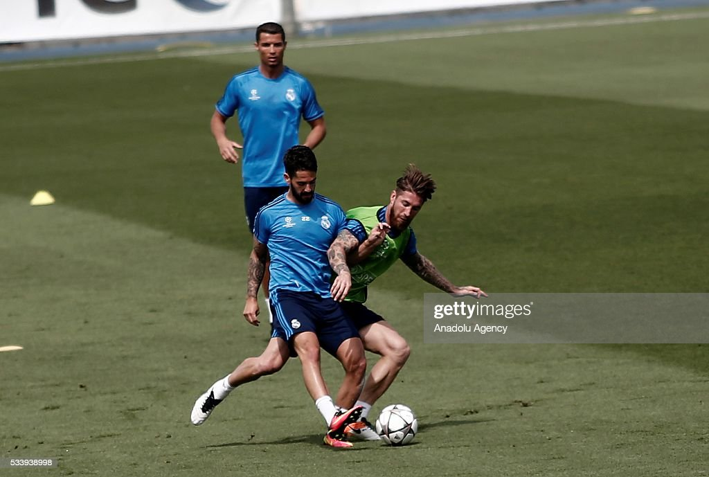 Cristiano Ronaldo (rear), Sergio Ramos (R) and Isco (R) of Real Madrid perform during their team's training session at the Valdebebas's sports complex in Madrid, Spain on May 24, 2016. Real Madrid will face Atletico Madrid in the 2016 UEFA Champions League final at Guiseppe Meazza stadium in Milan, Italy on May 28, 2016.