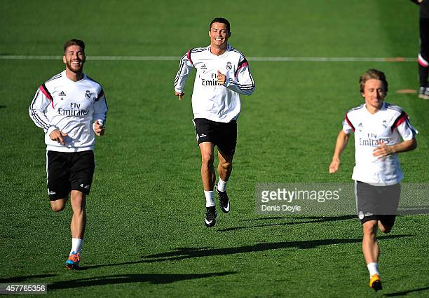 Cristiano Ronaldo Sergio Ramos and Luka Modric of Real Madrid CF warm up during a team training session the day before their La Liga match against FC...
