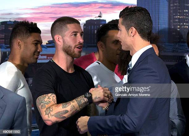 Cristiano Ronaldo shakes hands with his teammate Sergio Ramos after receiving his trophy as alltime top scorer of of Real Madrid CF at Honour boxseat...