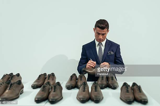 Cristiano Ronaldo signs 10 pairs of CR7 Footwear during the global launch of his FW15 collection Each pair will be put in to circulation to be...